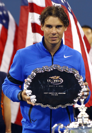 Rafael Nadal holds up the runners up trophy after the US Open fi