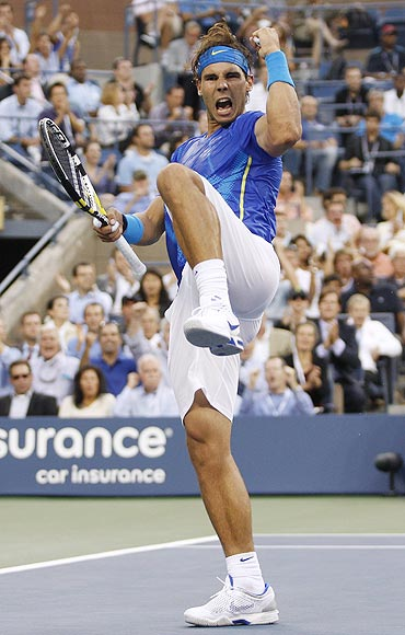Rafael Nadal celebrates a point against Novak Djokovic