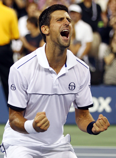 Novak Djokovic of Serbia reacts after he won match point against Rafael Nadal of Spain