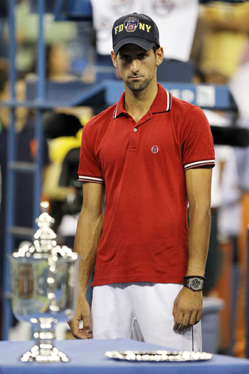 Novak Djokovic of Serbia looks on during the trophy ceremony