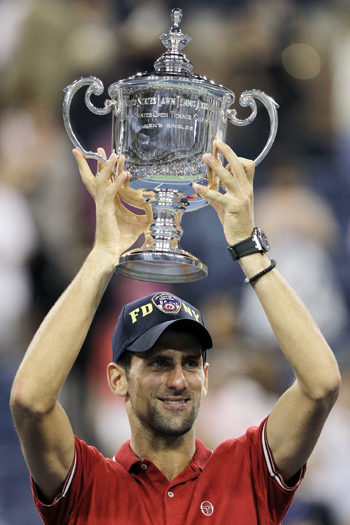 Novak Djokovic of Serbia celebrates with the trophy after he defeated Rafael Nadal of Spain during the Men's Final on Day Fifteen of the 2011 US Open