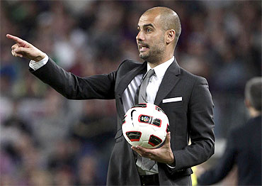 Barcelona's coach Pep Guardiola gestures during their Spanish first division soccer match