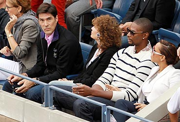 Actor Thomas Gibson (left), NBA star Chris Bosh (2nd from right) and his wife Adrienne (right) at the US Open woman's final