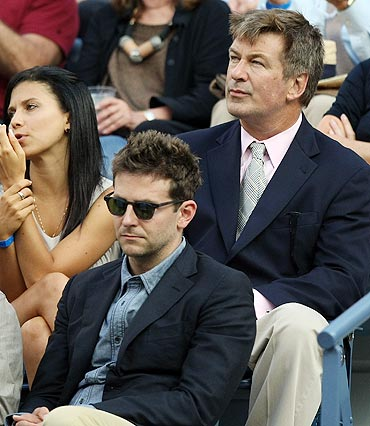 Actors Alec Baldwin (top right), Bradley Cooper (bottom right) and Ron Rifkin watch the US Open men's final between Rafael Nadal and Novak Djokovic