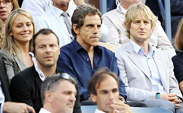Actors Christine Taylor, Ben Stiller and Owen Wilson watch the US Open men's final between Rafael Nadal and Novak Djokovic