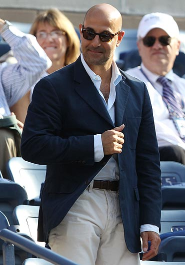 Actor Stanley Tucci watches the US Open men's final between Rafael Nadal and Novak Djokovic