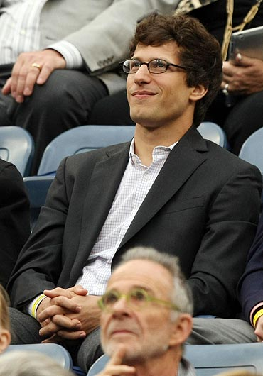 Andy Samberg attends the woman's final between Samantha Stosur and Serena Williams