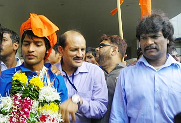 Yuvraj Walmiki with former India stars Mir Ranjan Negi and Dhanraj Pillay at Mumbai's domestic airport