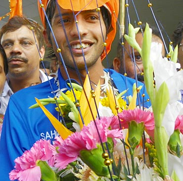 Yuvraj Walmiki is welcomed at the Mumbai domestic airport