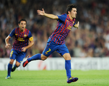David Villa of FC Barcelona celebrates scoring his sides second goal during the UEFA Champions League group H match between FC Barcelona and AC Milan at the Camp Nou
