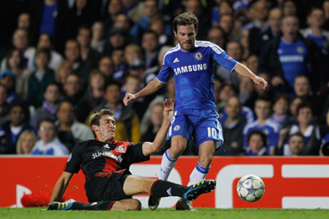 Stefan Reinartz of Bayer Leverkusen tackles Juan Mata of Chelsea during the UEFA Champions League Group E match