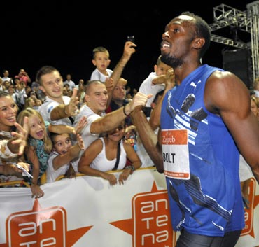 Usain Bolt of Jamaica is congratulated by fans after winnig the men's 100 meters event at the IAAF Grand Prix in Zagreb on Tuesday