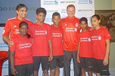 Phil Thompson and Sreeram Iyer, Regional COO, India and South Asia, Standard Chartered Bank, (extreme left) with the children representing Mumbai's municipal schools at the launch of the 'GO FORWARD' program at a city hotel on Wednesday