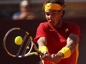 Spain's Rafael Nadal returns a shot to France's Richard Gasquet