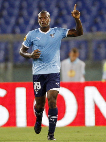 Lazio's Djibril Cisse celebrates after scoring against FC Vaslui during their Europa League Group D soccer match at the Olympic stadium in Rome