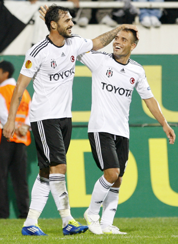 Hugo Almeida (L) of Besiktas celebrates his goal with his teammate Ekrem Dag during their Europa League Group E soccer match against Maccabi Tel Aviv at Inonu stadium in Istanbul