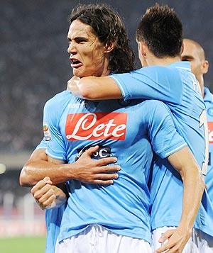 Edinson Cavani of Napoli celebrates with teammates after scoring against AC Milan on Sunday