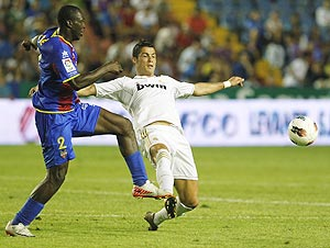Real Madrid's Cristiano Ronaldo (right) and Levante's Arouna Kone vie for possession