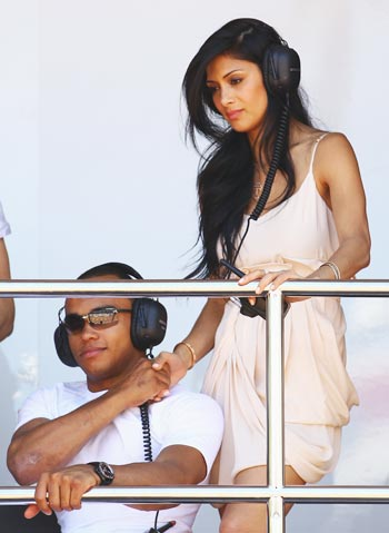 Nicole SAcherzinger of the Pussycat Dolls, girlfriend of Lewis Hamilton of Great Britain and McLaren Mercedes, is seen with Nic Hamilton, brother of Lewis