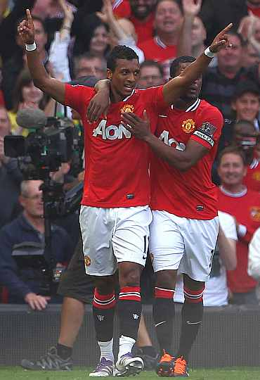 Manchester United's Nani celebrates after scoring against Chelsea at Old Trafford