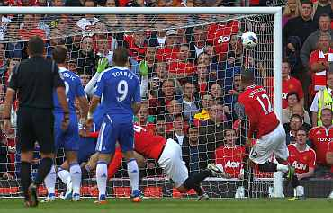 Chris Smalling scores for Manchester United against Chelsea