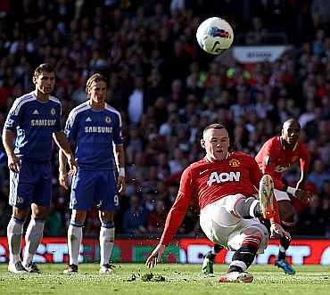 Wayne Rooney reacts after missing a penalty