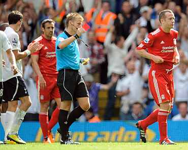 Liverpool's Charlie Adam recieves a red card from referee