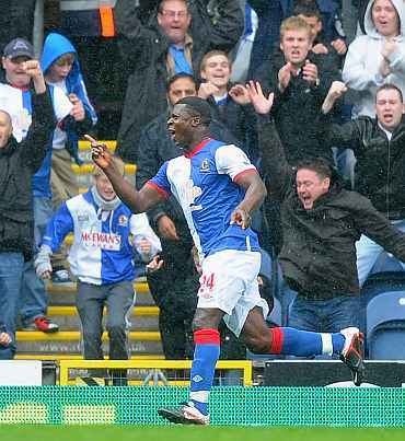 Yakubu celebrates after scoring against Arsenal