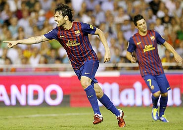 Barcelona's Cesc Fabregas celebrates after scoring against Valencia