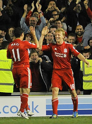 Liverpool's Dirk Kuyt (right) celebrates with team-mate Maxi Rodriguez after netting against Brighton and Hove Albion during their League Cup match on Wednesday