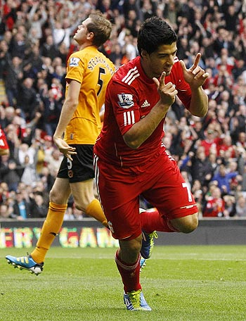 Liverpool's Luis Suarez (R) celebrates after scoring during their English Premier League soccer match against Wolverhampton Wanderers