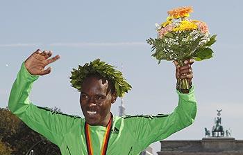 Patrick Makau of Kenya celebrates after winning the Berlin Marathon in Berlin, on Sunday