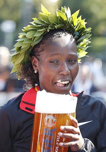 Florence Kiplagat of Kenya tastes German alcohol-free beer after winning the Berlin Marathon on Sunday