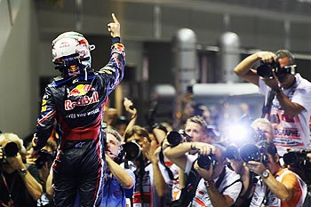 Sebastian Vettel Red Bull Racing celebrates on the podium after winning the Singapore Formula One Grand Prix
