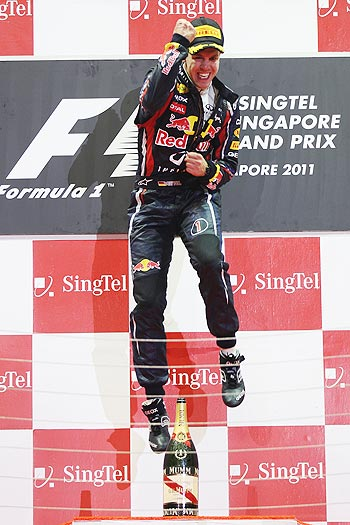 Sebastian Vettel of Red Bull Racing celebrates in parc ferme after winning the Singapore Formula One Grand Prix
