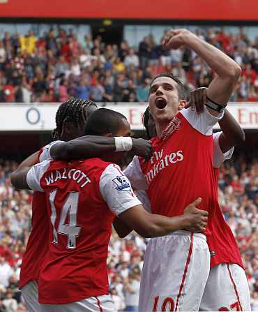 Arsenal's Robin van Persie celebrates after scoring