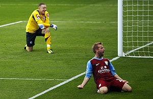 Aston Villa's Barry Bannan (right) celebrates scoring from the penalty spot past Queens Park Rangers goalkeeper Paddy Kenny during their English Premier League match at Loftus Road in London on Sunday