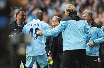 Manchester City players with manager