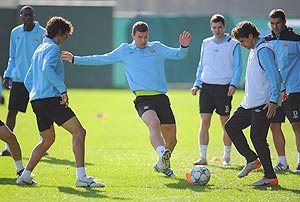 Edin Dzeko (centre) with teammates during a Manchester City training session
