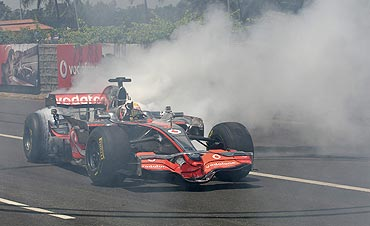McLaren Formula One driver Lewis Hamilton does a burn-out in an F1 car on an unused section of the Banglore-Mysore highway on Tuesday