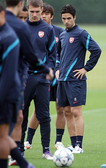 Mikel Arteta of Arsenal looks on during a training session