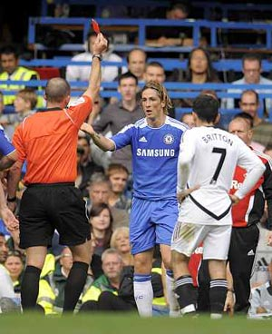 Fernando Torres recieves a red card against Swansea on Saturday