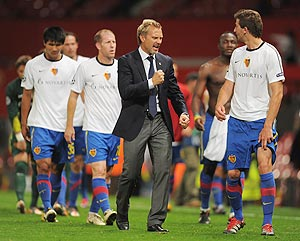 Thorsten Fink manager of FC Basel celebrates with player David Abraham after their  Champions League match against Manchester United on Tuesday