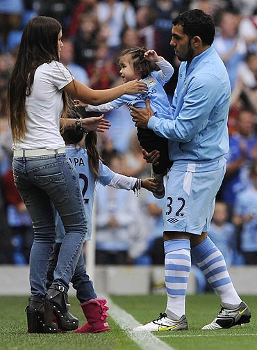 Manchester City's Carlos Tevez (right) with his children and wife Vanessa
