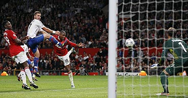 Manchester United's Ashley Young (2nd from right) heads a goal against FC Basel