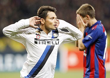 Inter Milan's Mauro Zarate (left) celebrates after scoring as CSKA Moscow's Pavel Mamaev looks on dejected
