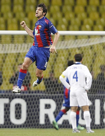CSKA Moscow's Alan Dzagoev celebrates after scoring against Inter Milan
