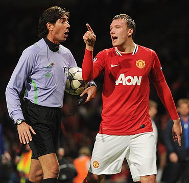 Manchester United's Phil Jones argues with a match official