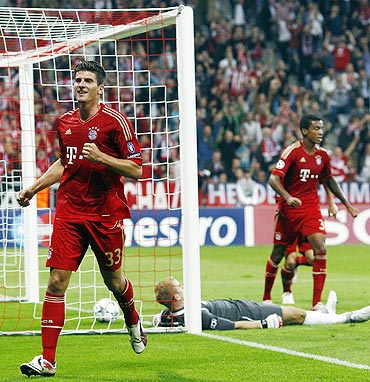 Bayern Munich's Mario Gomez (left) celebrates after scoring against Manchester City