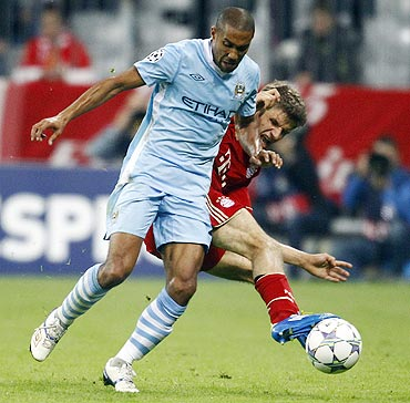 Bayern Munich's Thomas Mueller (right) challenges Manchester City's Gael Clichy